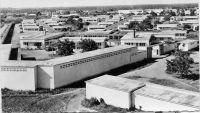 Lomé, vue générale de l'hôpital de Tokoin  - Le CHU de Lomé Tokoin remplace à partir de 1954 l'hôpital Reine-Charlotte de Lomé, principal établissement hospitalier du Togo depuis son ouverture en 1909. L'architecte de l'hôpital de Tokoin, Henri Crouzat, est également à l'origine du plan d'urbanisme de Lomé datant de 1948. Il reste cependant plus connu pour ses romans Azizah de Niamkoko, oeuvre régionale décrivant le Togo colonial et L'île du bout du monde porté à l'écran en 1958.